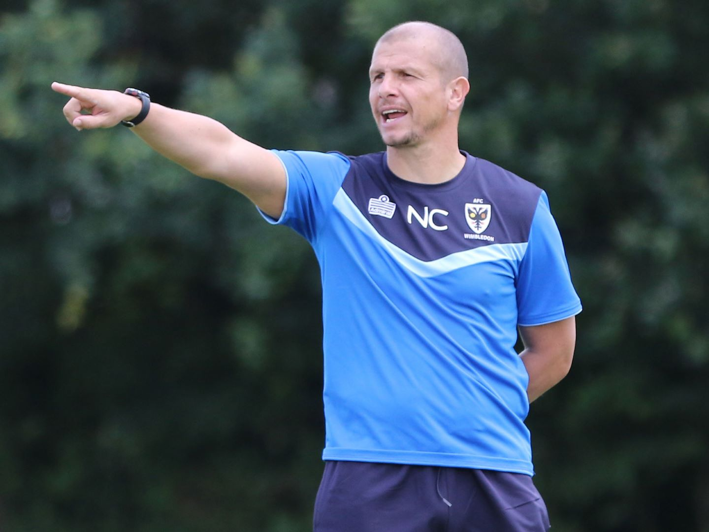 Neil Cox gives instructions during a training session