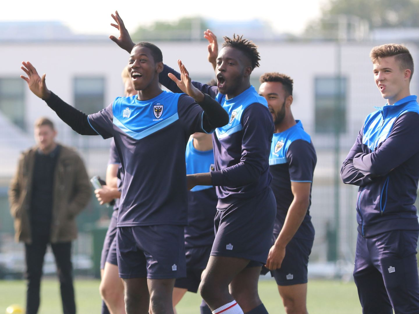Players celebrating during training at the Southfields Academy